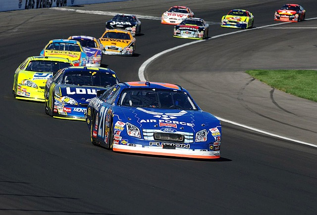 Branded Nascars racing round an American Oval Track.