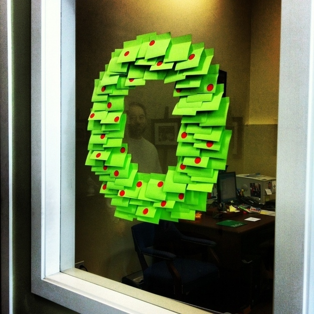 A wreath created using green post it notes.