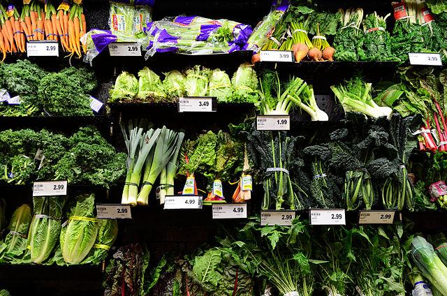 Vegetables on a shelf at a supermarket.
