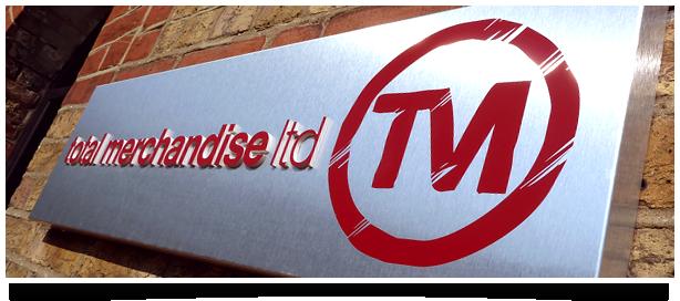 The longer version of the Total Merchandise logo.