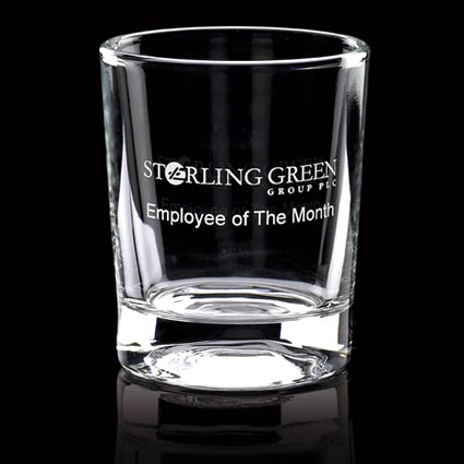Promotional Mini Tot Glasses manufactured from high quality crystal in a minimalistic, modern shape that would sit well in countless locations from conference rooms and offices to bars and restaurants. These personalised glasses are small and round with a generous branding area which can be either traditional engraved or invert engraved - a stunning technique that is perfect for fine detail and offers the option of up to 4 colour infill if desired for higher impact of your artwork. A high quality glass that will flaunt your brand in any environment at an affordable price.